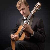 Classical Guitarist with a Master's degree in performance. Skilled in theory, history, and performance.