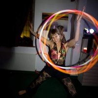 Colourful creative movement and flow artist with a passion for hoola hoops
