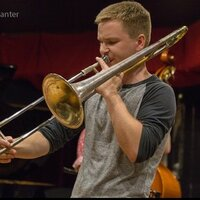 International competition-winning trombonist with a degree from the Eastman School of Music.