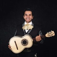 Mariachi guitarist with 5 years of performance experience hoping to spread the love of music to many more people from my home.