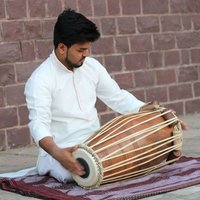 Pakhawaj, The Rhythmic flow of beats which derives the true introduction of the adorned percussionist- ROMAN DAS