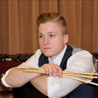 Percussionist with a Master's Degree, two albums, and two international competition victories.