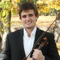 Violinist with a doctoral degree from the University of Colorado, Boulder and 14 years teaching experience